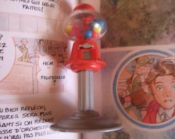 Doll candy dispenser