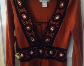 Rust and Black colored Women's Boho Sweater top.  Crochet details.