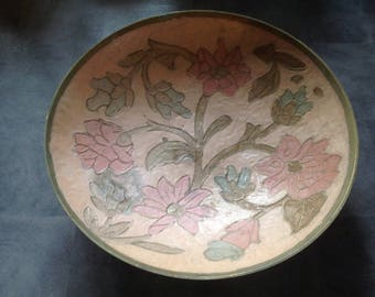 A brass hand decorated bowl