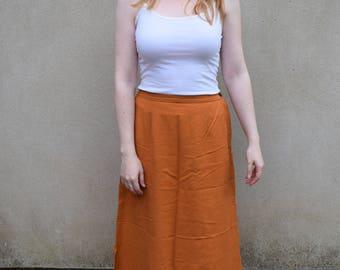Vintage Tribal Area orange maxi skirt, size medium