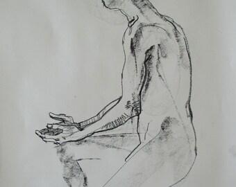 Conté crayon life drawing of a man sitting