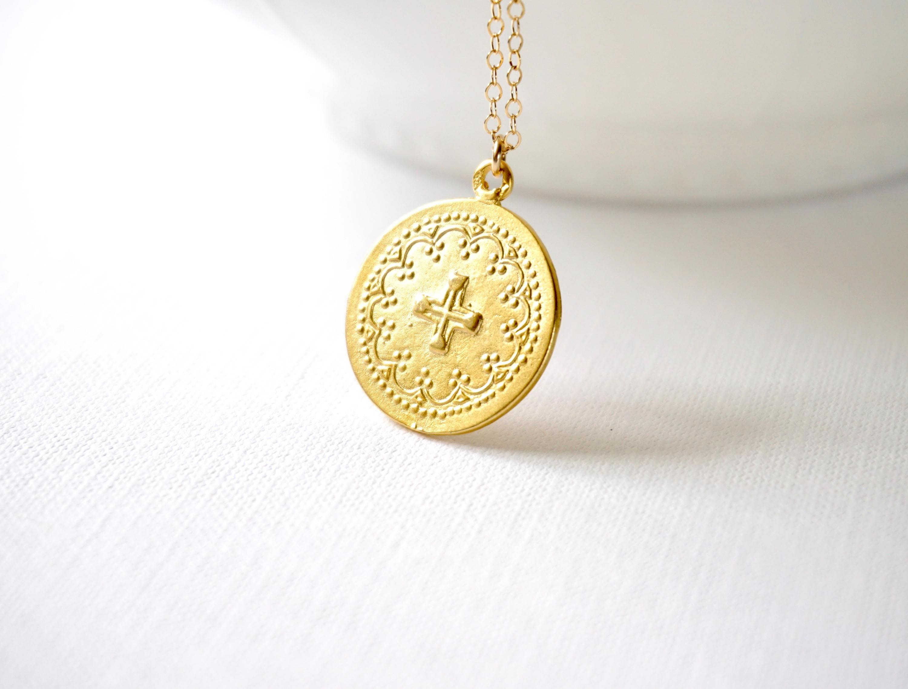 medallion pendant pin hands praying gold finish white