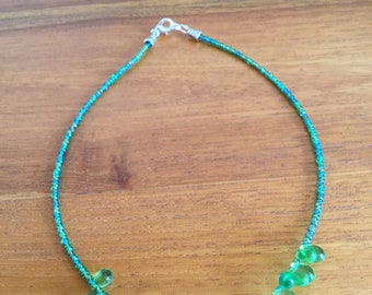 Green woman necklace
