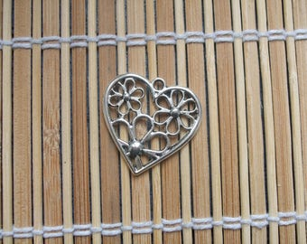 1 ornate silver color metal heart charm
