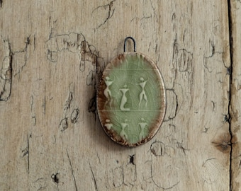 Handmade green and bronze connector with ancient people