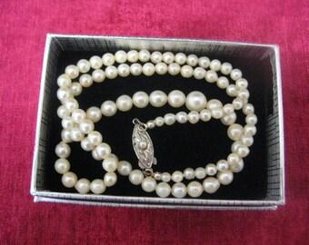 Antique Art Deco sea-pearls necklace with silver lock. Descending