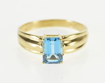 10k Emerald Cut Blue Topaz Soliatire Scalloped Ring Gold