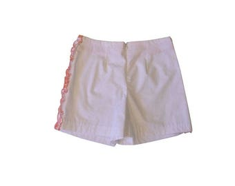 Orange shorts with Ruffles on the sides white and printed