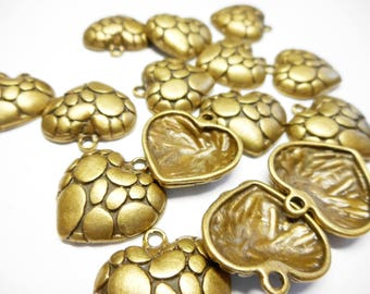 Set of 4 heart charms, bronze.