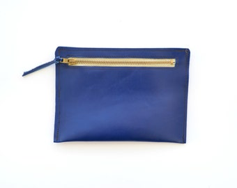 Blue leather pouch with zipper in front