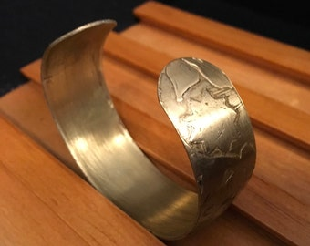 nature etched brass cuff.