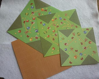 Origami Kit to create a Christmas tree and a prefitted scene background.