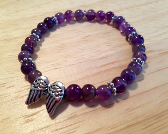 Amethyst gemstone bracelet with angel wing accent bead
