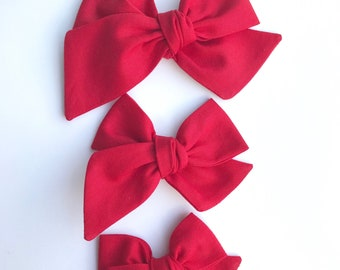 Red hand tied bow •large, medium, or small• headband or hair clip