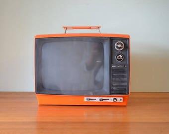 Vintage Orange portable TV HMV Nipper 12 television