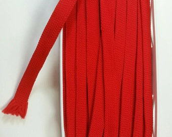 Red braided trim by Kim Trim folded 5/8 in. wide - open 1 1/4 in. total of 19yds.