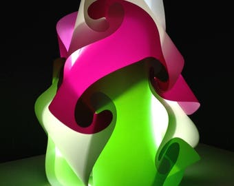Lamp has put large size green, pink and white