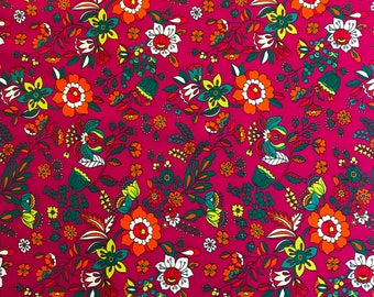 100% Cotton print floral fabric in white, spring green, orange, etc on a magenta background; for apparel and quilting
