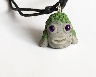 Stone creature pendant in nature, be fantastic, creature of magic nature