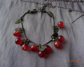 Cherry bracelet, translucent red beads copper colored leaves