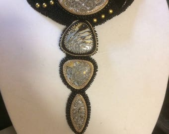 SOLD. Bead embroidery collar with black/white/gold beads and clay pendants.