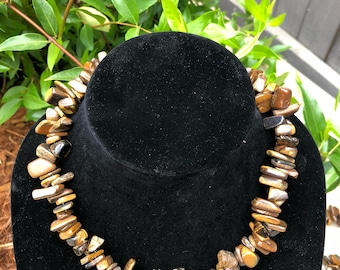 Tiger eye stone necklace with gold accent beads.