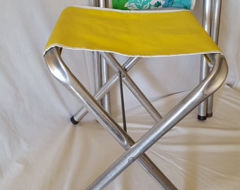 Aluminum camp stools, one turquoise and one yellow from the 1960's
