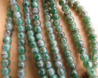 Set of 100 4 mm glass beads painted color: larch Green / Black, brass trim.