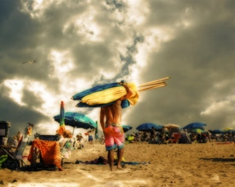 Bumbershoots is a photographic art print of a blustery day on Rehobeth Beach