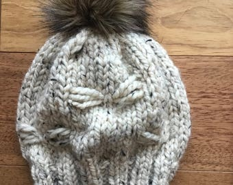 Unique oatmeal hat with embellishments and fur pom