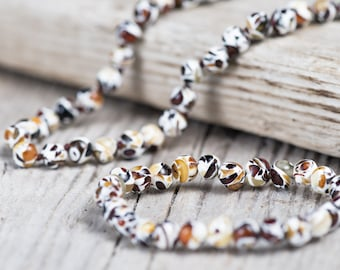 Baltic amber teething necklace and bracelet. Polished