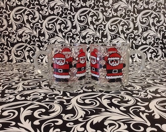 Wrapped in Santa~Set of 2~Santa Clause Mugs~Clear Glass~USA