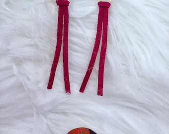 Dark pink leather tassel earrings with gold tone hardware