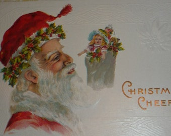 Santa Claus In Red Hat With Holly and Toys Antique Christmas Postcard