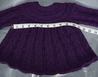 A baby dress in purple