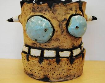 Monster plant pot with horns, ceramic sculpture