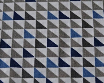 White background and blue triangle geometric pattern cotton fabric