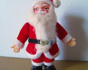 Mid Century Santa doll. Little kitschy Santa Claus ready to brighten your wreath, mantle, or centerpiece. 5.25 inches. Jolly old elf!