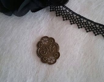 filigree connector with calligraphy and flowers metal bronze