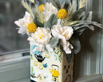 Vintage tea tin (blue and yellow teapots) flower arrangement