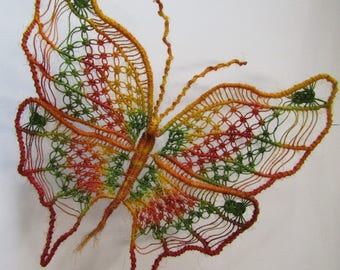 Macrame Butterfly wall decoration, handmade using hemp string painted. Yellow, red and green.