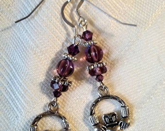 Purple and Sterling silver pierced earrings with silver plated Claddagh charms.