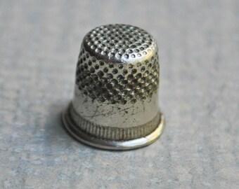 Vintage metal thimble.
