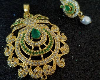 Elegant jewelry set with pendant and matching earrings