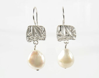 Fresh white water pearl dangling from a squarish Sterling silver leaves print.