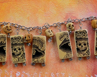 Day of the Dead Jewelry – Catrina with Skulls – Charm Bracelet with altered bamboo beads by Artist Cindy Couling
