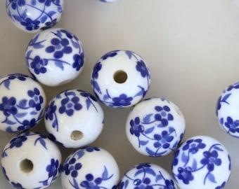 set of 4 blue flower decorated porcelain beads