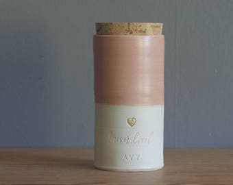 Custom urn with gold, straight shape. choice of color, name, date. Modern urn. shown in White porcelain, rhubarb pink urn. vitrifiedstudio.