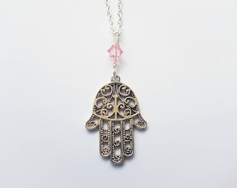 Hamsa hand charm necklace with light pink crystal bead drop