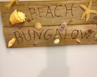 Wooden,Beach/yoga themed wall hanging art made from recycled materials, using seashells and weathered  wood